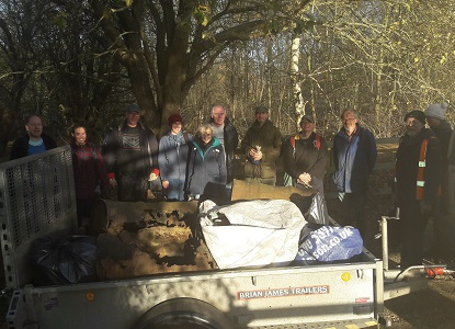 The volunteers with a trailer full of rubbish collected from the north heath